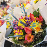 """Throughout August, overnight guests at downtown Seattle hotels will enjoy a complimentary bouquet of Pike Place Market's famous flowers as part of the organization's new """"Seattle in Bloom"""" promotion."""